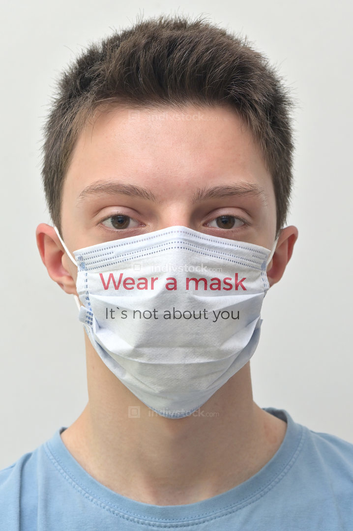Young Man Wearing Medical Mask With Tagline Words