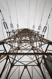Abstract pattern from bottom view of high voltage pole power tra