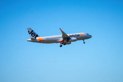 Auckland Airport, New Zealand - February 25, 2020: A Jetstar airplane is landing at the Auckland Airport.