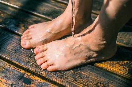 Bare feet on wood