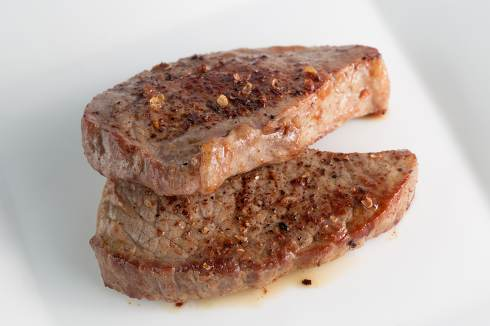 BBQ Steak. Barbecue Grilled Beef Steak Meat with Vegetables. Hea