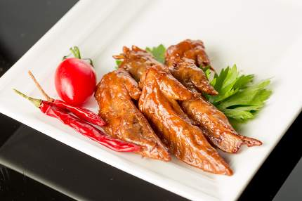 Braised duck wings, Chinese cuisine.