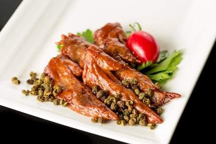 Braised duck wings, Chinese cuisine.