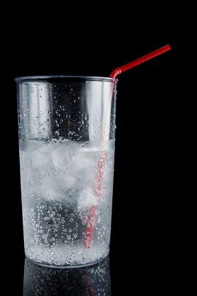 ice and soda in cup - closeup