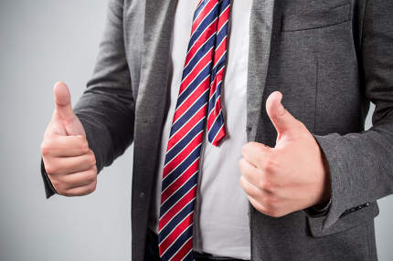 Business man shows thumb up good!