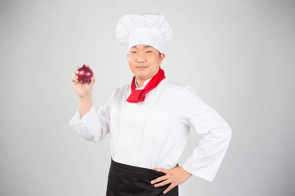 chef holding spring onions nice photo