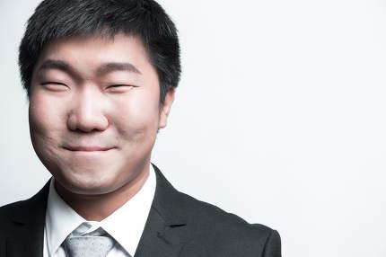 Confident businessman posing happy isolated