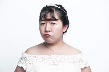 Closeup portrait of young gorgeous bride sad