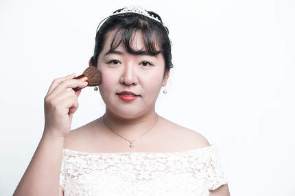 A bride getting her makeup done