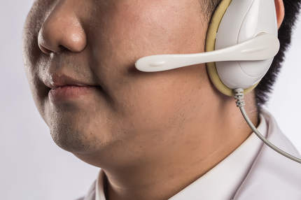 Medical doctor in headset working in office