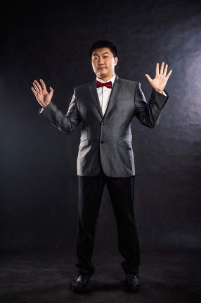 Photo of stylish man in elegant black suit studio shot
