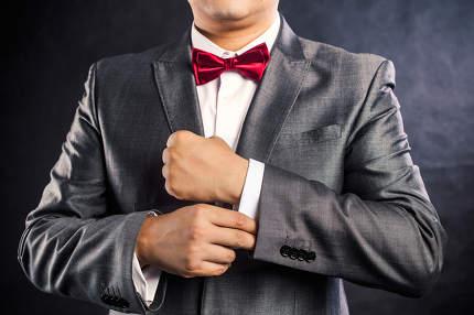 Mans hands with cufflinks and clocks. Elegant gentleman clother