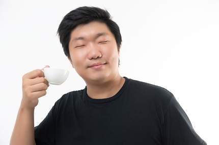 close up of man hands holding cup of coffee close up