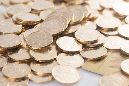 many coins on a white background