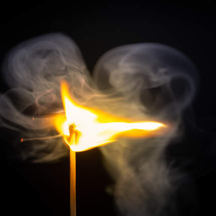match flame dark background
