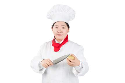 portrait of chef cook holding a knife