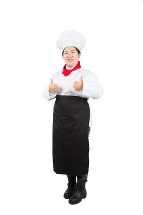 smiling female chef, cook or baker showing thumbs up