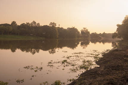 the Landscape and sunset at the Mae Nam Kok River in the city of Chiang Rai in North Thailand.   Thailand, Chiang Rai, November, 2019