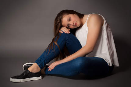Young woman is sitting on floor
