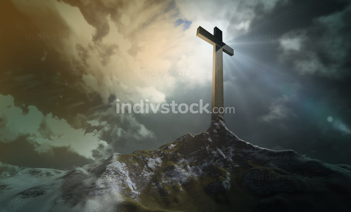 A wooden cross on a hill at sunset