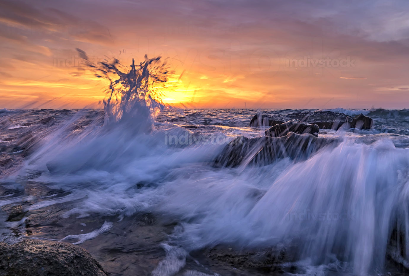Amazing splash of seawater at sunrise on the shore of the Black