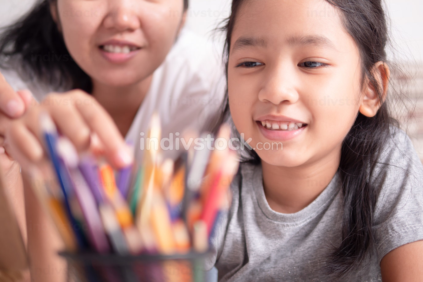 Asian little girl and a woman selecting a color