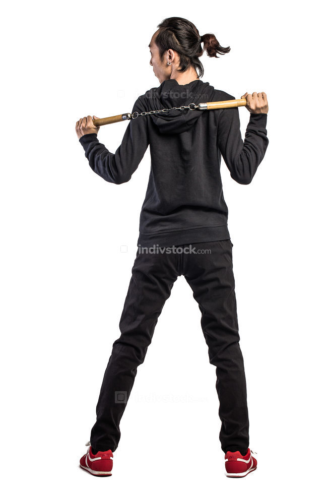 asian man in a hood is using nunchaku