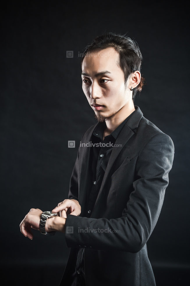 Asian man in a white shirt with black suit