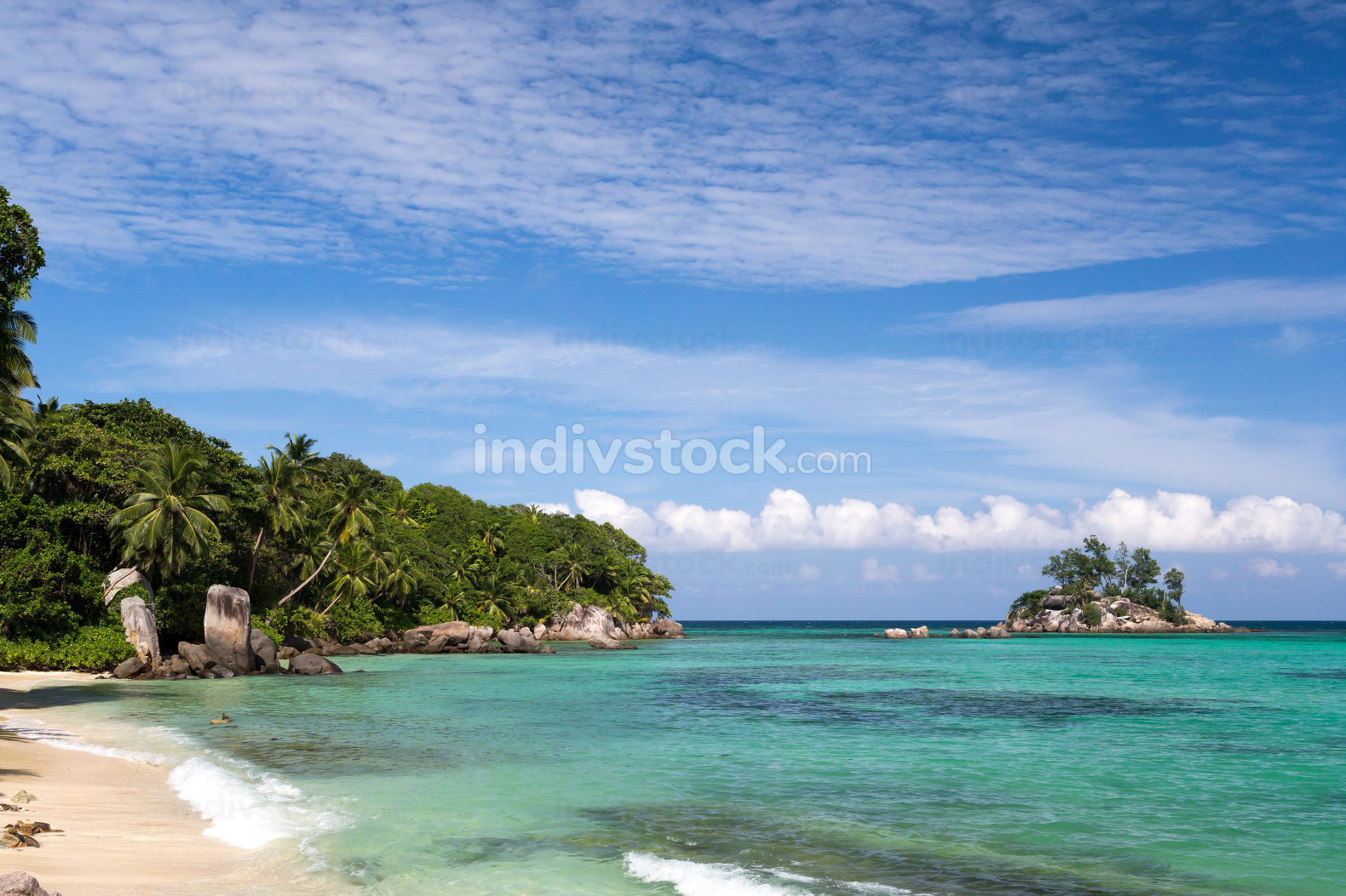 beach with a small island in the near, Seychelles