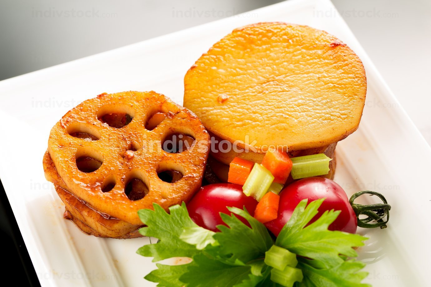 Braised lotus root and potatos, Chinese cuisine.