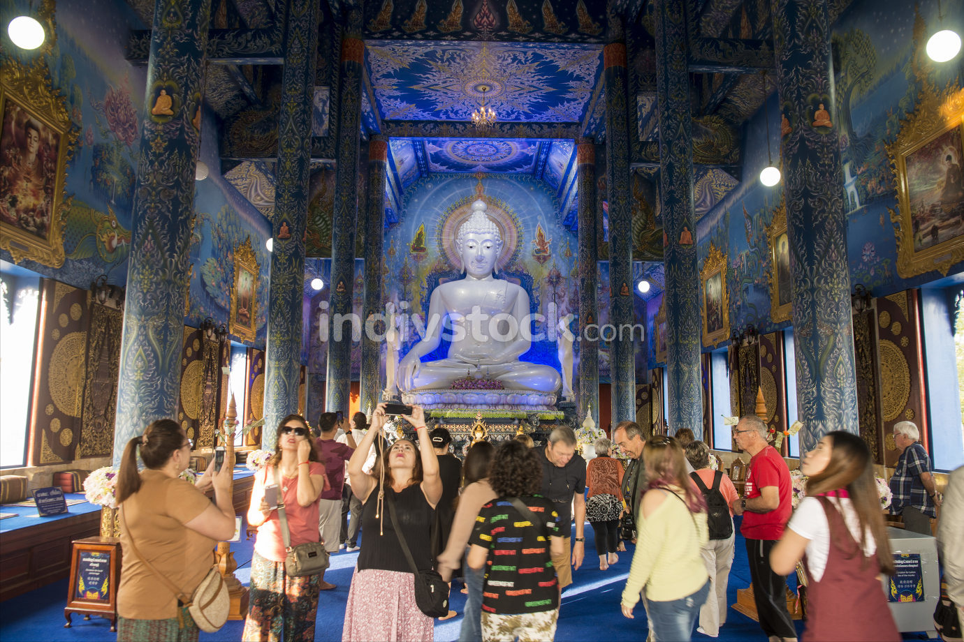 chinese tourists at the Buddha statue in the Blue Temple or Wat Rong Suea Ten in the city of Chiang Rai in North Thailand.  November, 2019