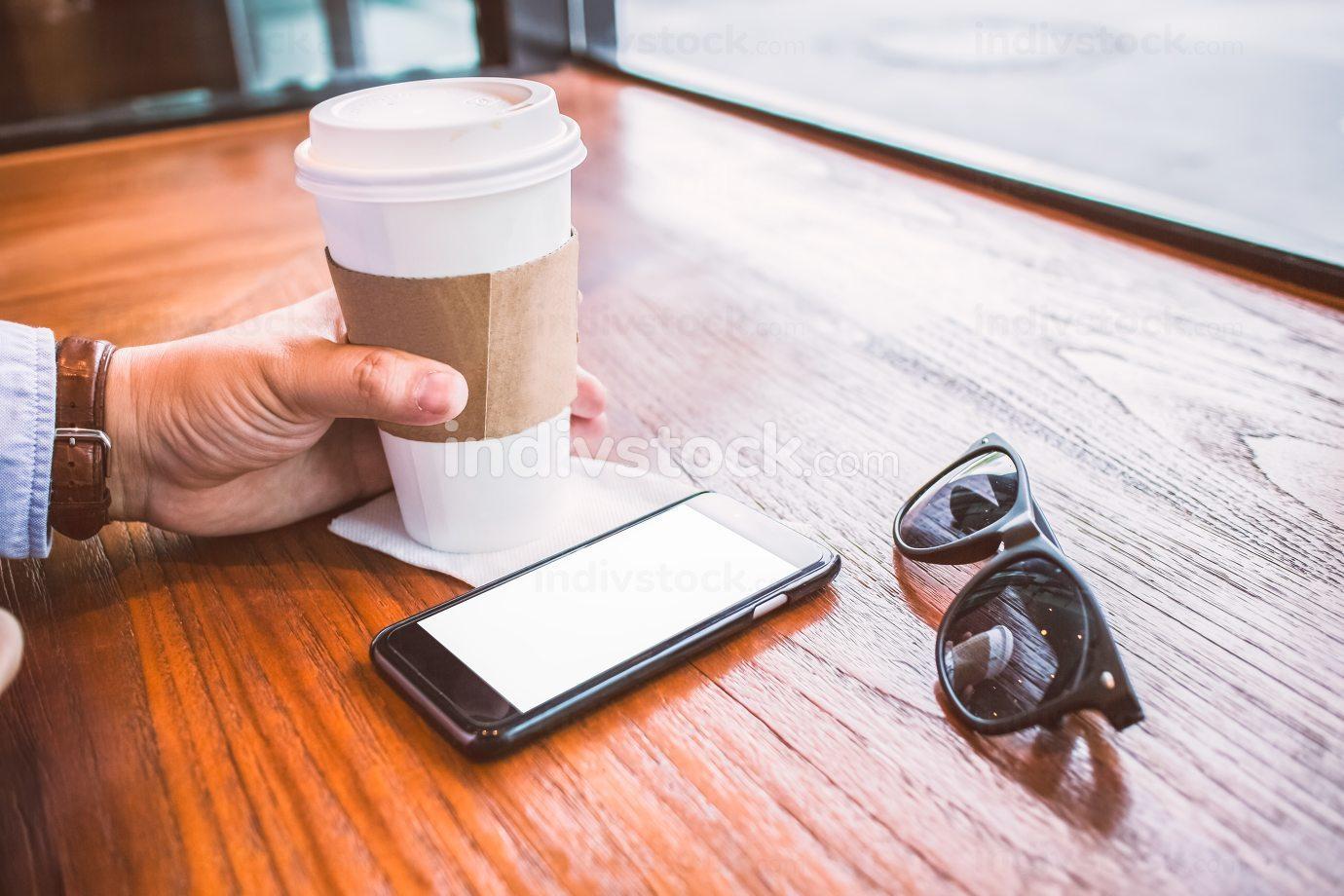 close up hands multitasking man cellphone