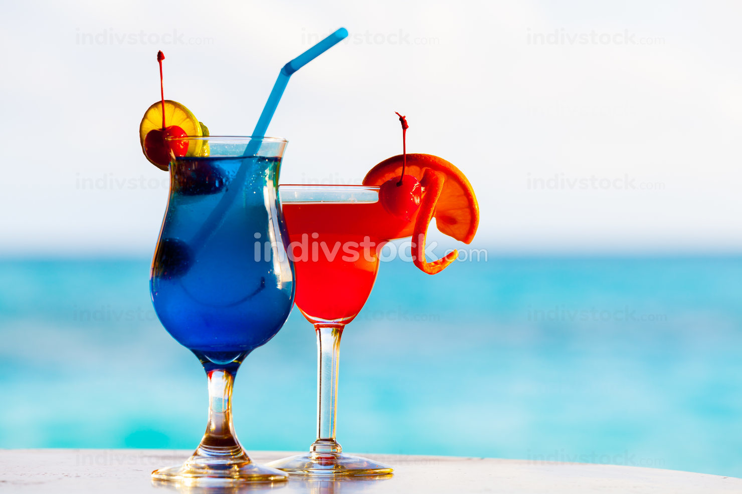 Colorful cocktails in front of the sea