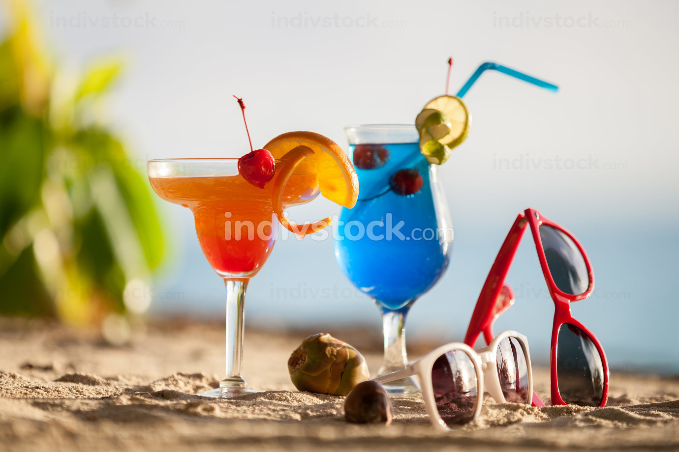 colorful cocktails standing on the sand