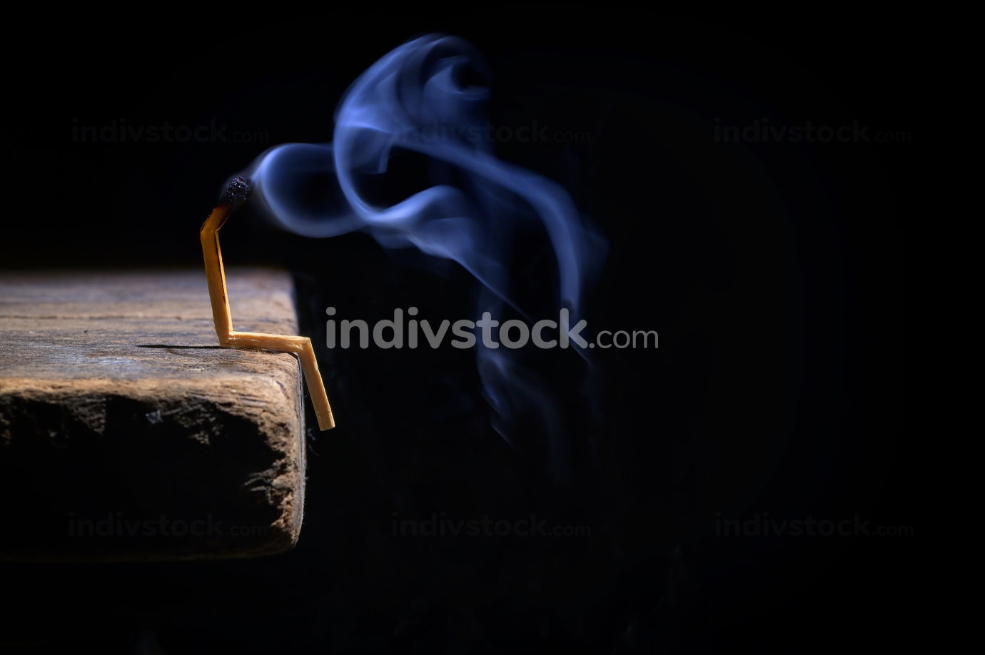 Conceptual burned out and smoke wooden matches