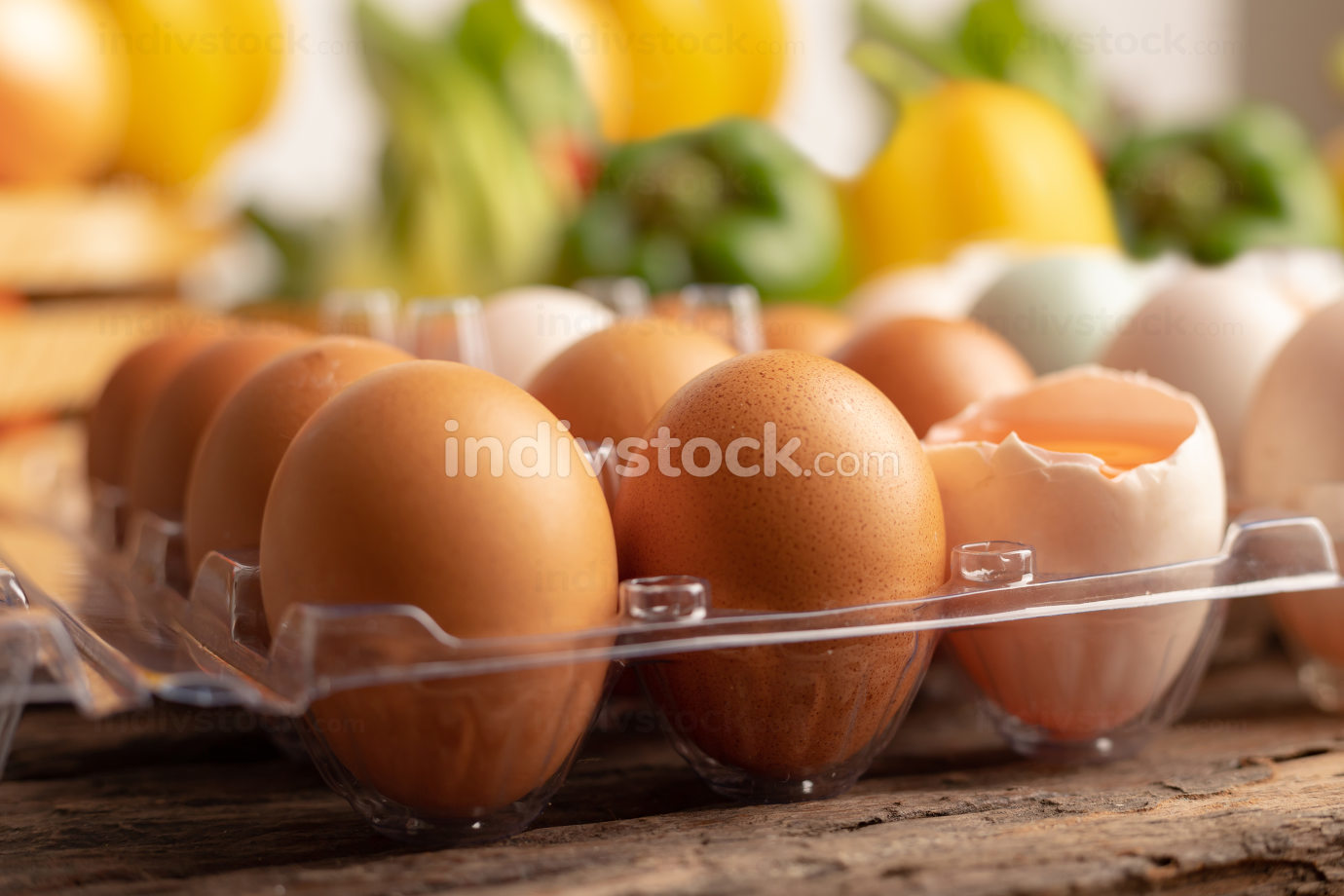 eggs of chicken placed on a wooden table with various vegetables