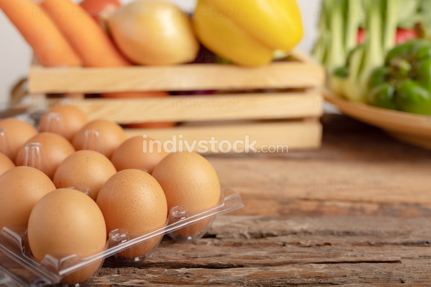 eggs on the wooden table and vegetable in a wood box