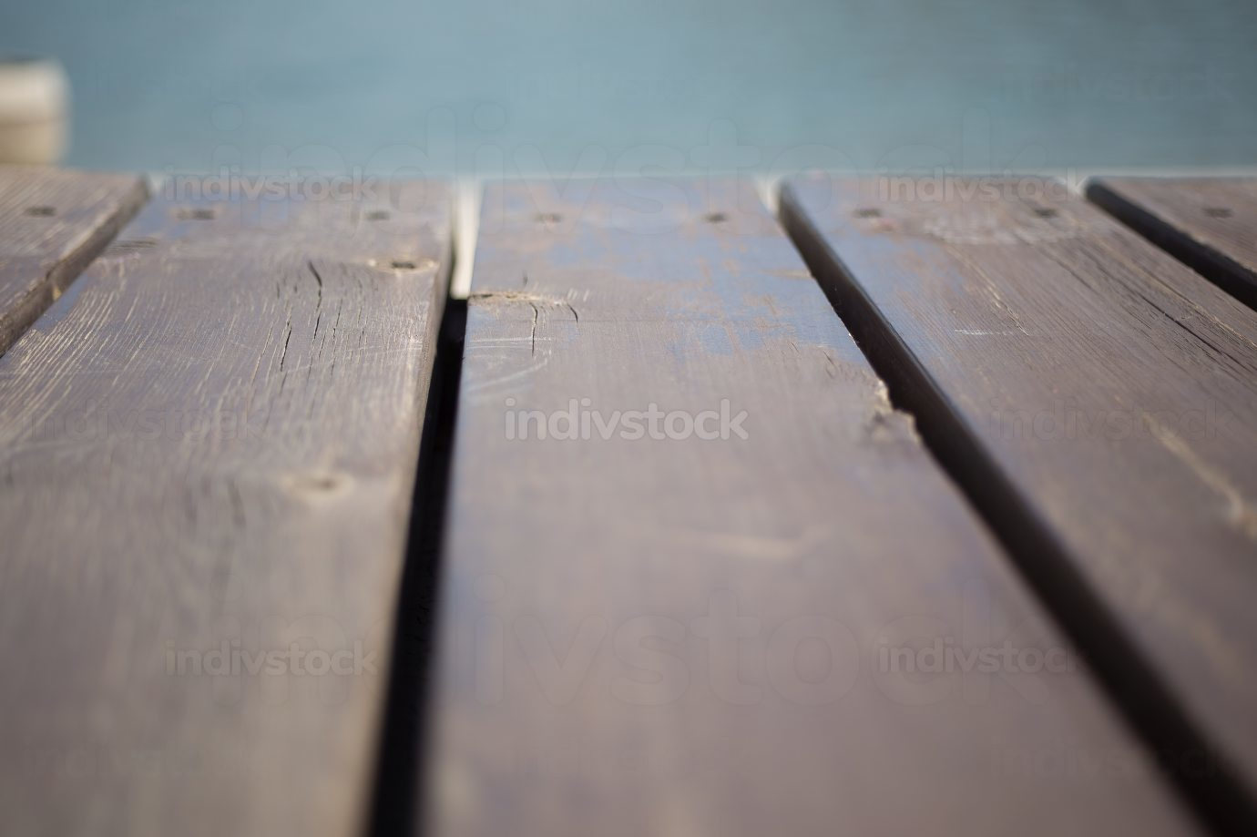 Empty wooden jetty on the lake shore