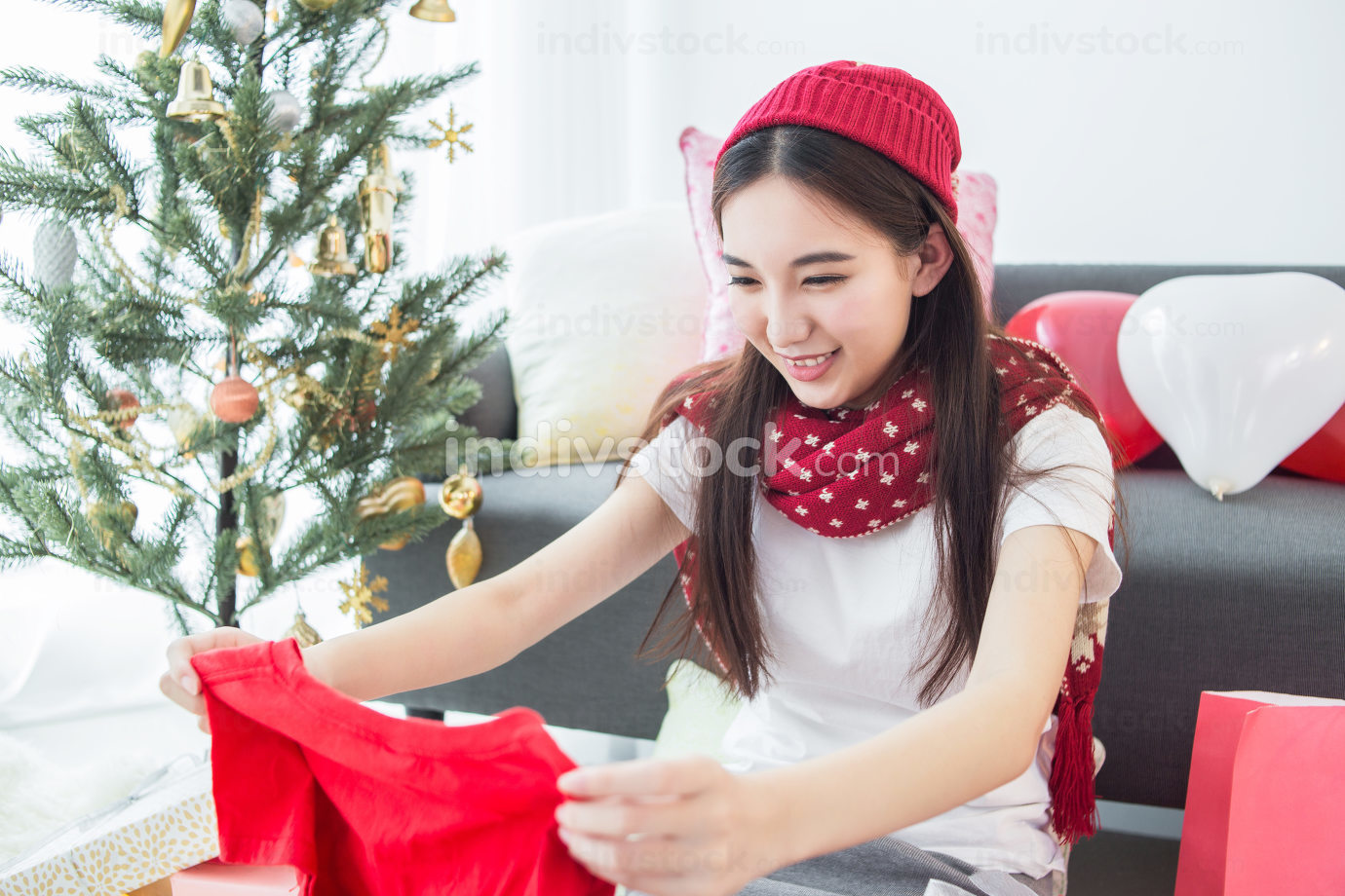 Girl receive new cloth in Merry Christmas