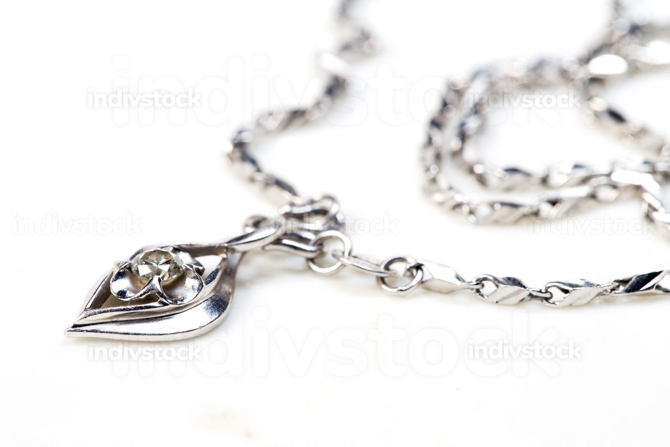 iamond heart pendant with necklace on white background.