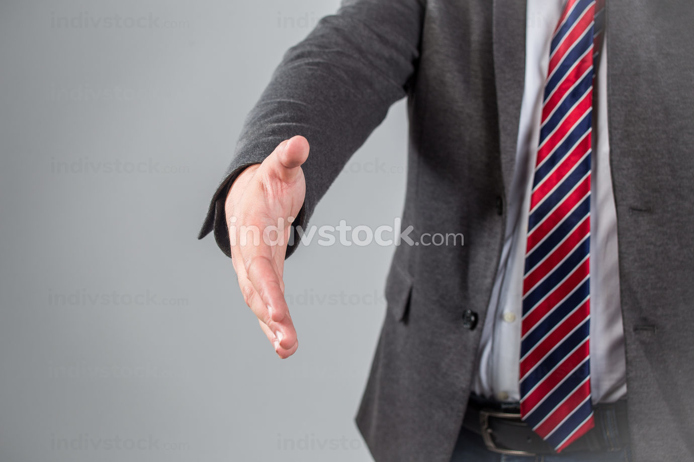 a man gives a hand toward to the camera