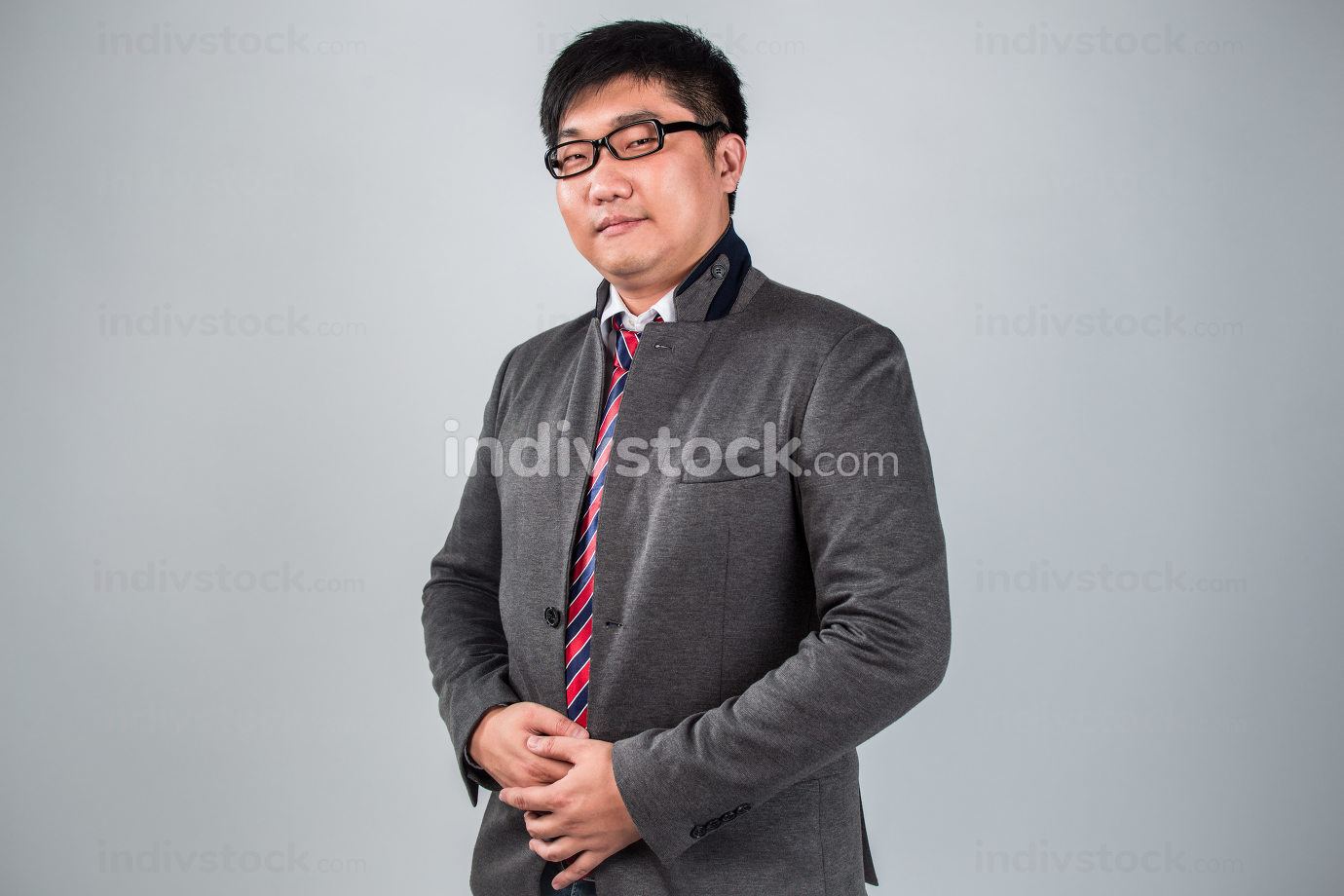 Man in suit wearing a glasses  good
