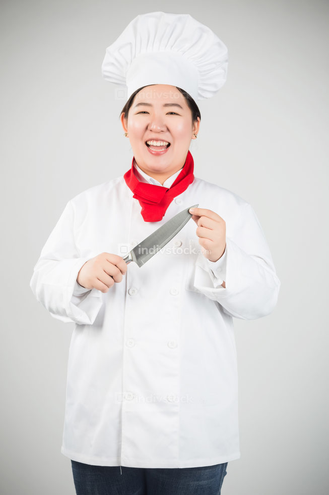 Closeup portrait of a male chef cook sharpening knife isolated on a white background