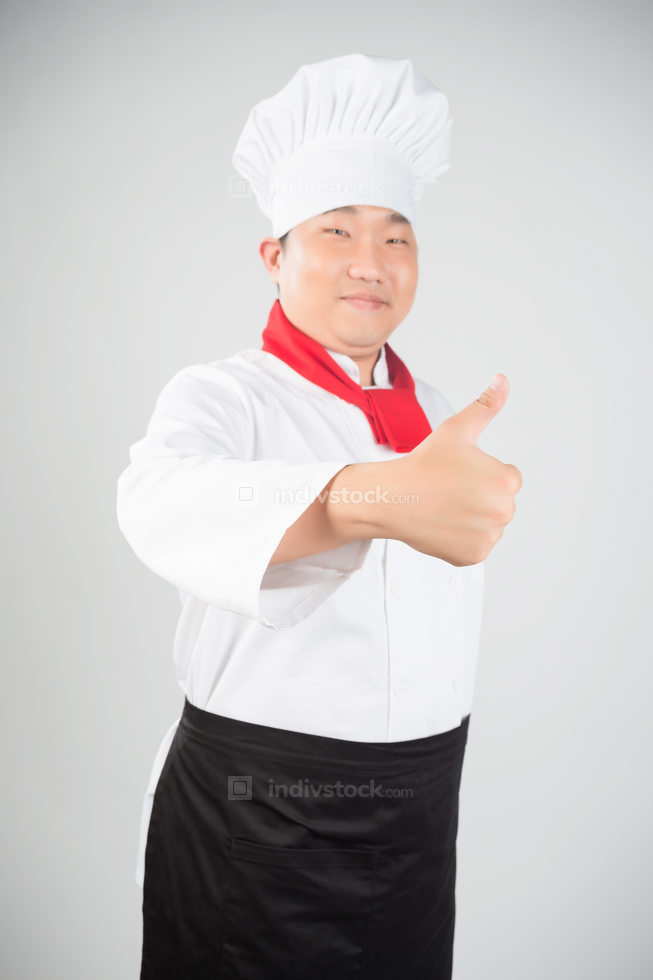 A male chef isolated over grey gradient background