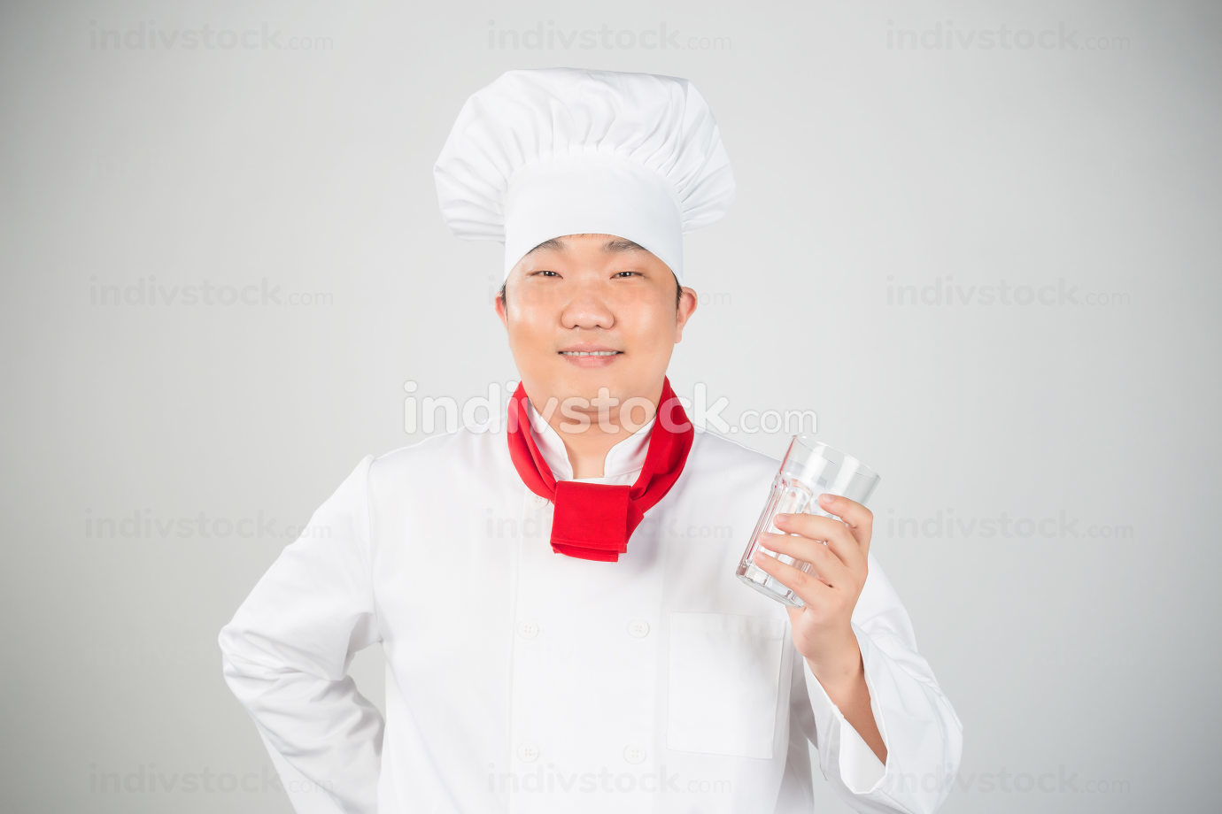 chef holding glass cup nice photo