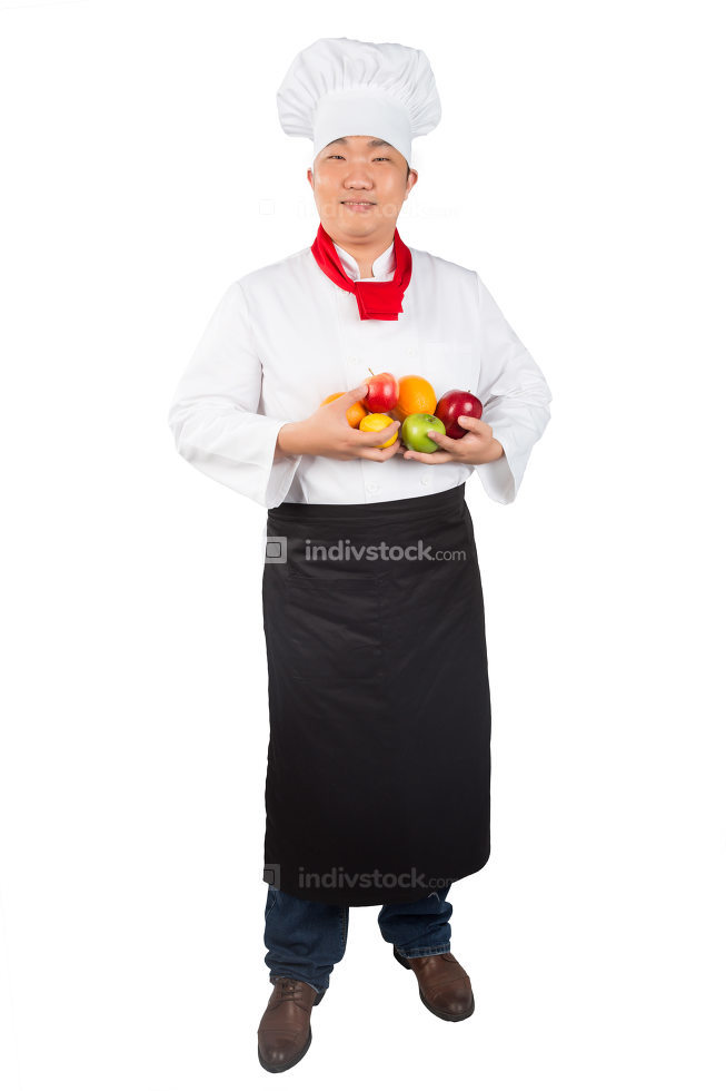 man in chef's hat with fruits on a white background