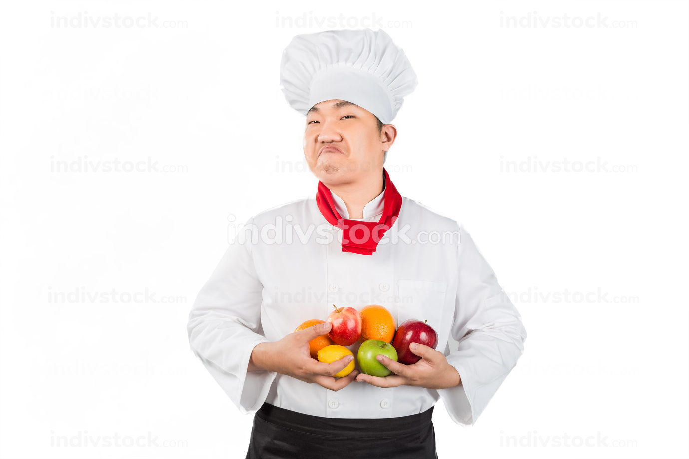 Chef holding fruits, isolated on white