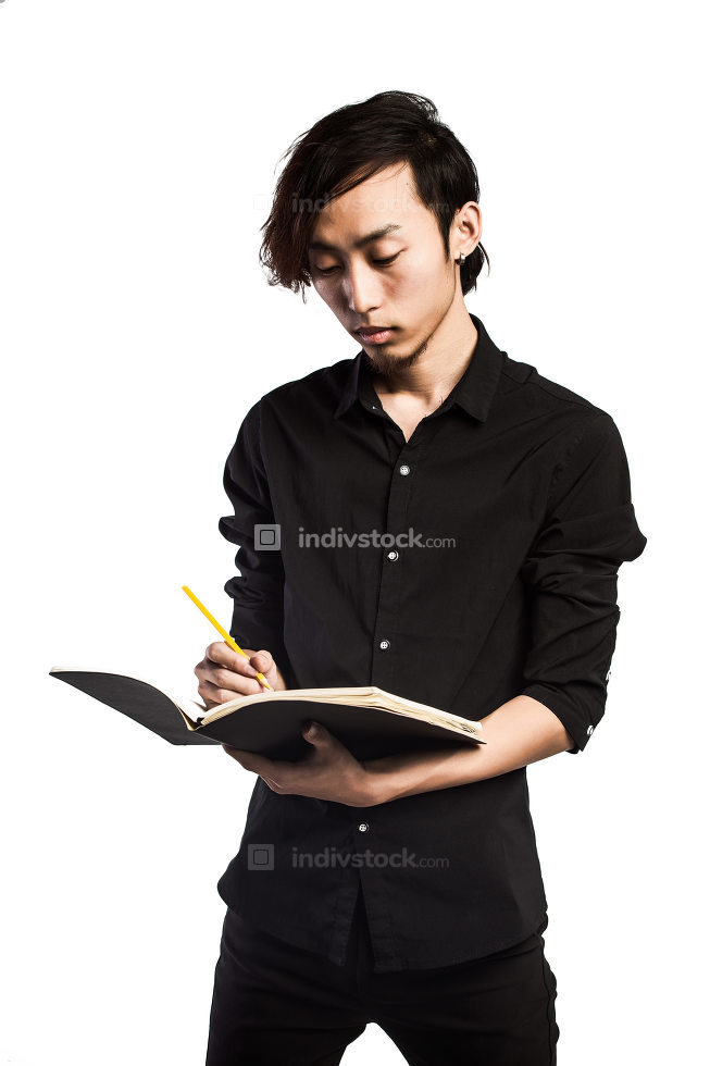 In Search Of Inspiration. A man with an empty notebook.