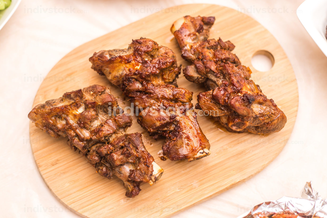 lamb leg roast on a steel plate