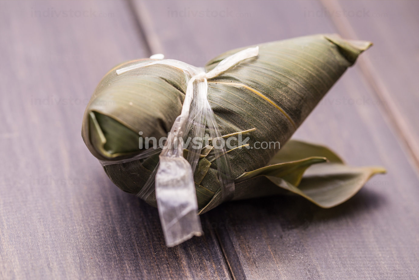 Asian Chinese rice dumplings or zongzi with tea on wood